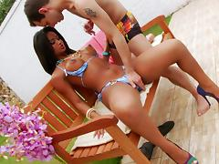 Gorgeous shemale with big boobs enjoying a hardcore fuck next to her swimming pool