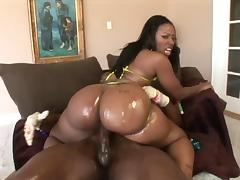An ebony BBW backs her oiled up big ass onto his thick dick
