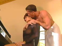 Dynamic tattooed dame with fake tits giving her gentleman stunning blowjob