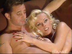 Glamorous blond Kelly Trump enjoys a nice long anal fuck