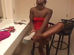 Ebony pole dancer uses feet to jack him off