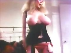 Vintage big boob babe strips and plays