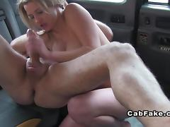 Busty brunette eats ass in fake taxi