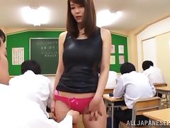 Horny Japanese teacher gets her hairy muff fingered madly in class