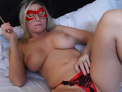 A blonde babe wears a mask while sucking the cum out of his cock