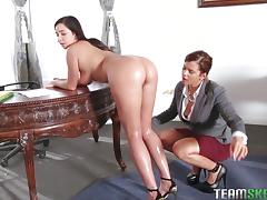 Horny female co-workers get out the strapon and fuck in the office