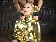 Curvaceous lady from Japan gets naked and painted in gold!