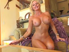 Jewel strips down and reveals her big naturals before masturbating
