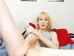 Blonde tgirl with tattooed body on live cam