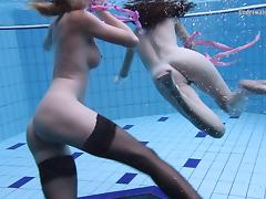 Nice ass lesbain teen widening legs while swimming in pool