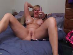 Blonde mature bombshell with big tits pleasures her twat with a toy