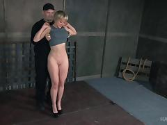 Sex slave with short hair hogtied during a BDSM session