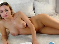 Naked blonde Milenaxxll lying on the sofa
