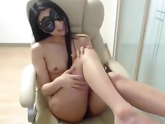 Oriental_girl: brunette fucks herself in a chair