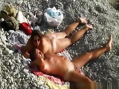 Interrupted nude beach handjob