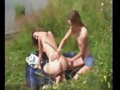 Two amateur girls undressing at lakeside