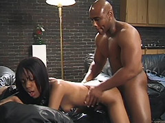 Ebony Couple is Performing a Unshaven Hardcore on a Black Leather Sofa