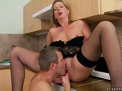 Mature hottie Laura Long enjoys sucking and riding a cock in the kitchen