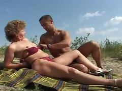 Mature whore blows on a beach and gets her pussy fucked hard