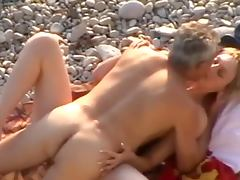Cute girl gets fucked by her elderly husband on a beach