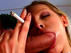 Hot blonde Liz Honey is smoking during blowjob