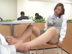 Kinky Japanese chick gives a footjob to a stranger