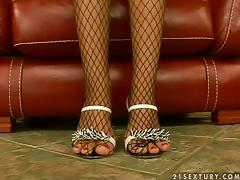 Bambi pulls her fishnet stockings down and boasts of her cute feet