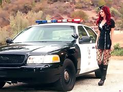 Elle Alexandra shakes her nice ass lying on a police car