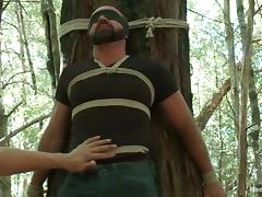 Bearded Josh West gets tied up and toyed deep in a forest