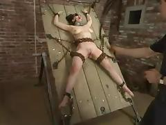 Chained Mallory Knots gets whipped and toyed adjacent to the aggravation