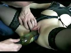 Milf gets fucked by a wine bottle