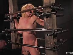 Krissy Lynn moans in pleasure while being tortured in a cellar