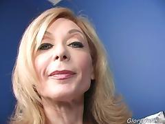 Mature blonde Nina Hartley sucks a BBC through a gloryhole