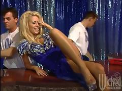 A smoking hot blond siren is getting fucked by two