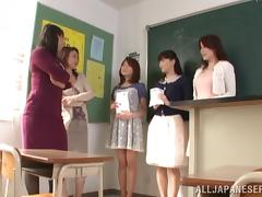 A Japanese teacher gets pounded on a table in a classroom