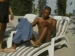 Two Black guys suck each others dicks and fuck by the pool