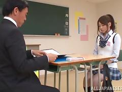 An Asian babe in a college uniform rides a dick in a classroom