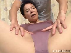Asian bitch gives a titjob and enjoys it deep doggy style