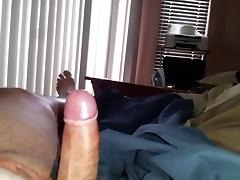 stroking my uncut cock, wifes hairy pussy in background